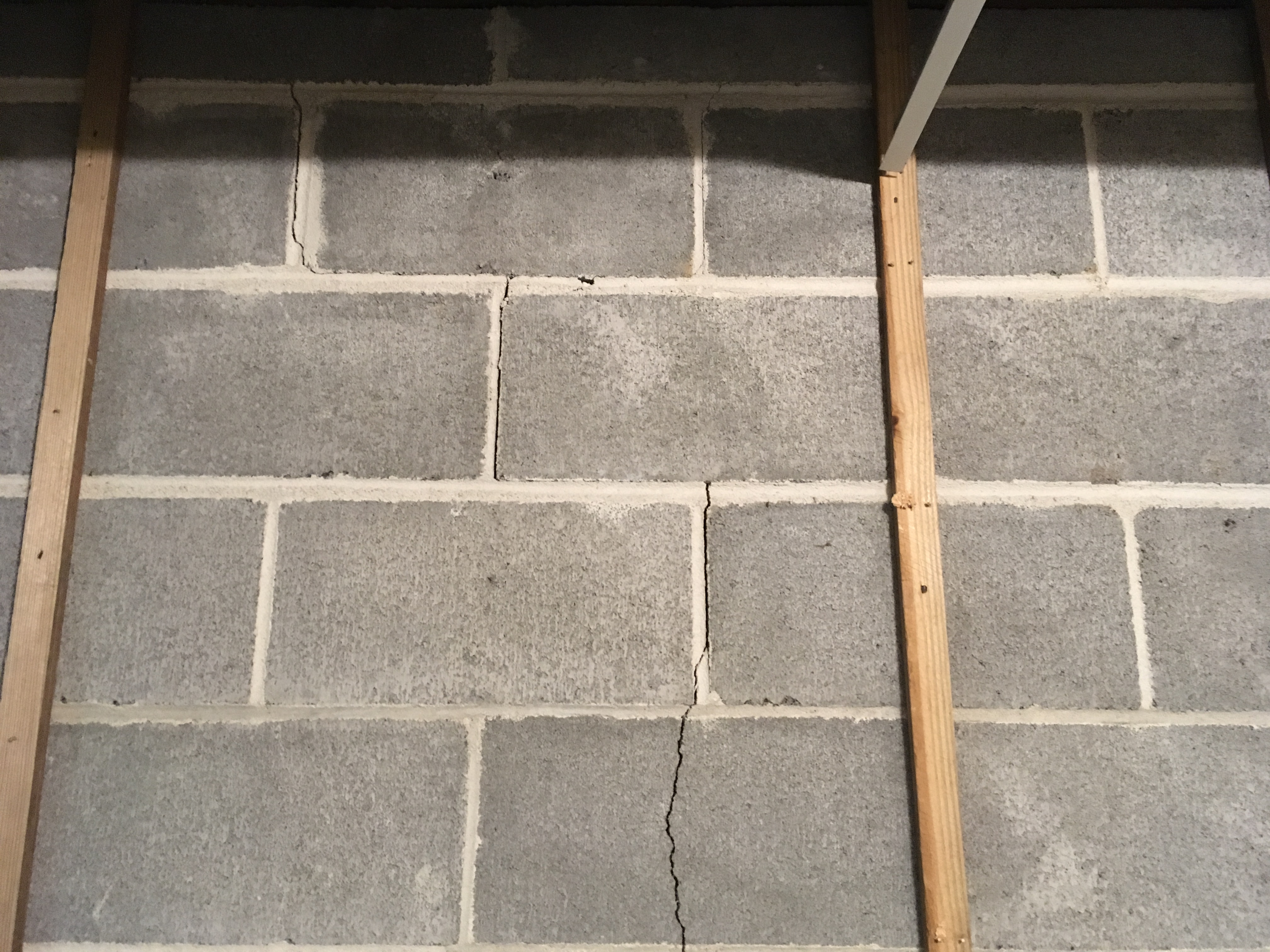 Stair stepping interior crack on basement block wall
