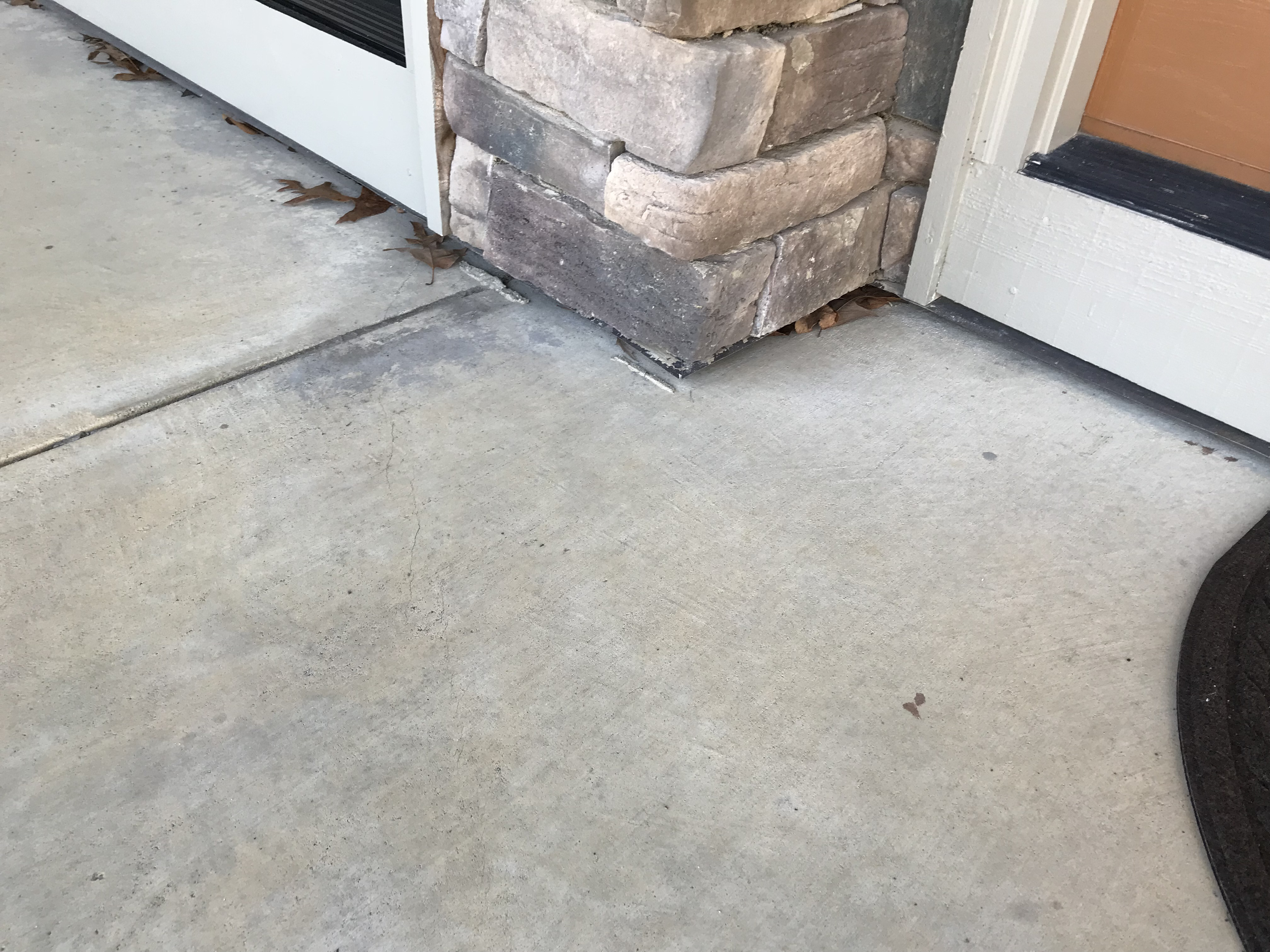 Concrete of the front porch separating from Arley home