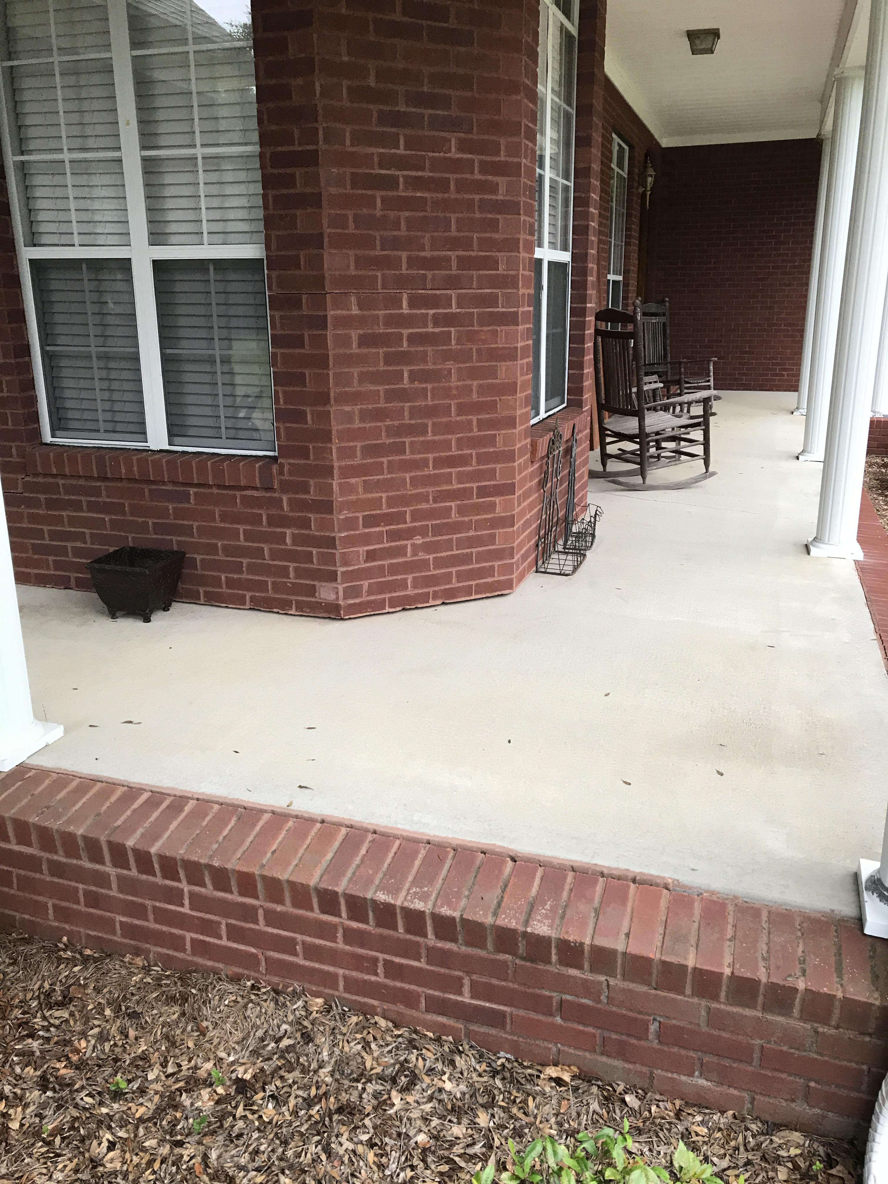 Concrete front porch sunken and separated