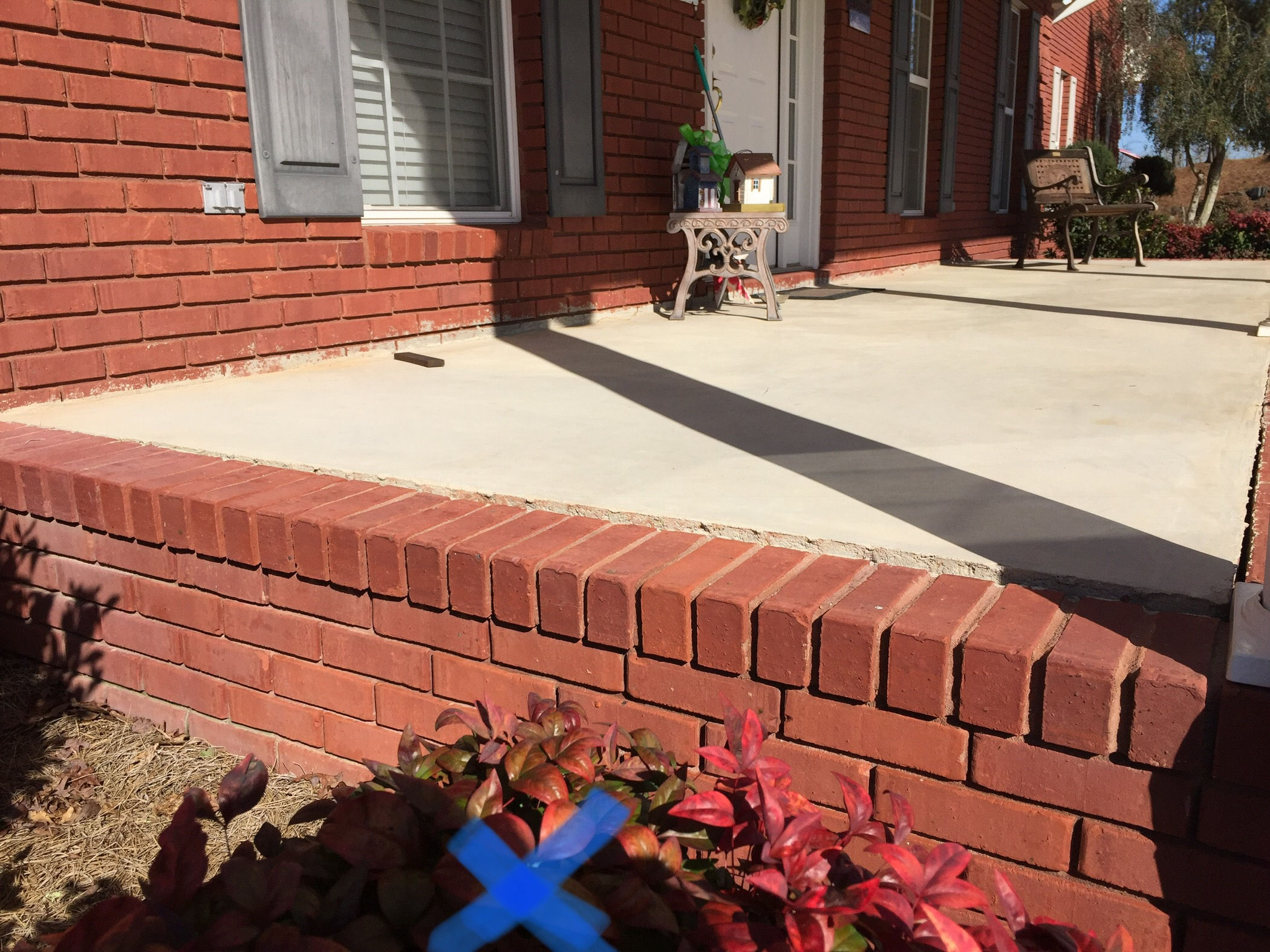 Concrete front porch sunken and separation in Clanton