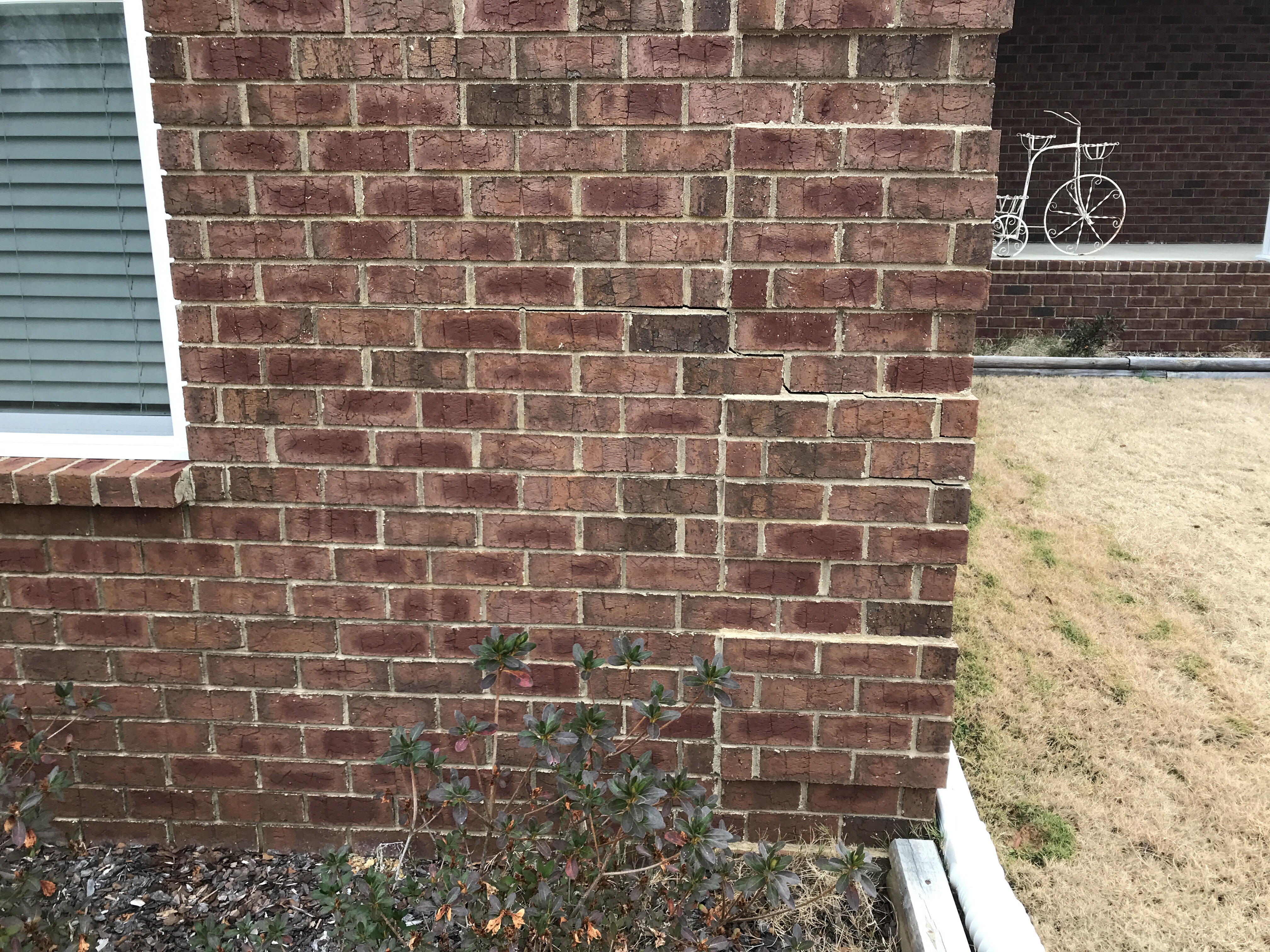 Horizontal to stair stepping crack on brick exterior wall